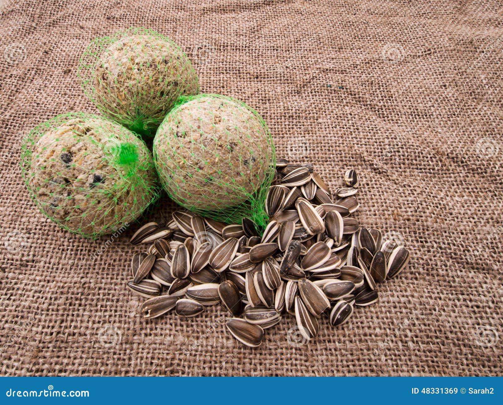 wild bird food fat balls and sunflower seeds on hessian. Black Bedroom Furniture Sets. Home Design Ideas
