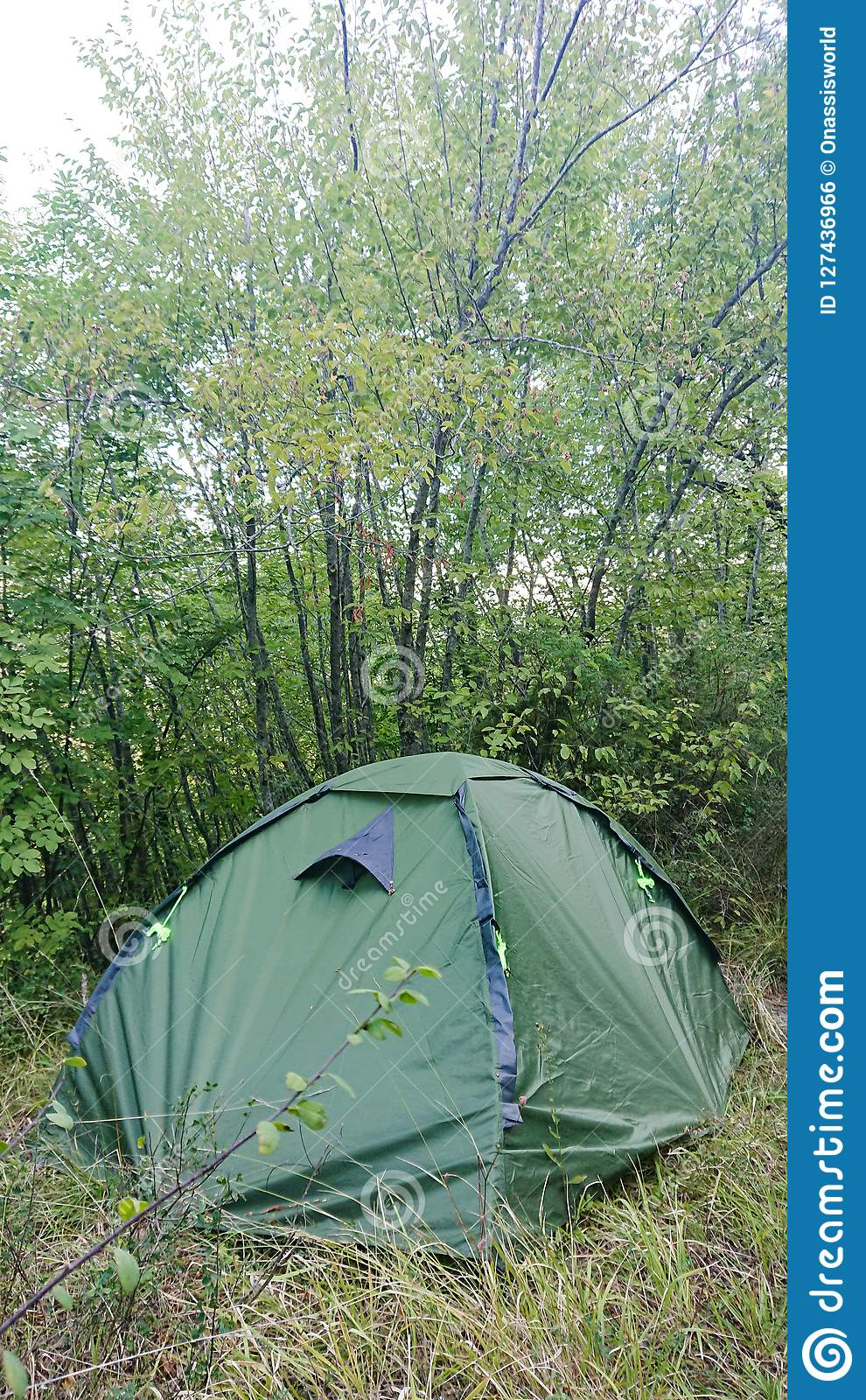 A two man green tent pitched in the countryside. & Wild Camping stock photo. Image of countryside pitched - 127436966
