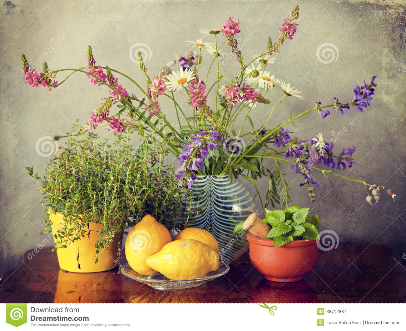 Beautiful pink flowers in the garden stock photography image - Wild Flowers In Vase Herbs And Lemon Fruits Royalty Free