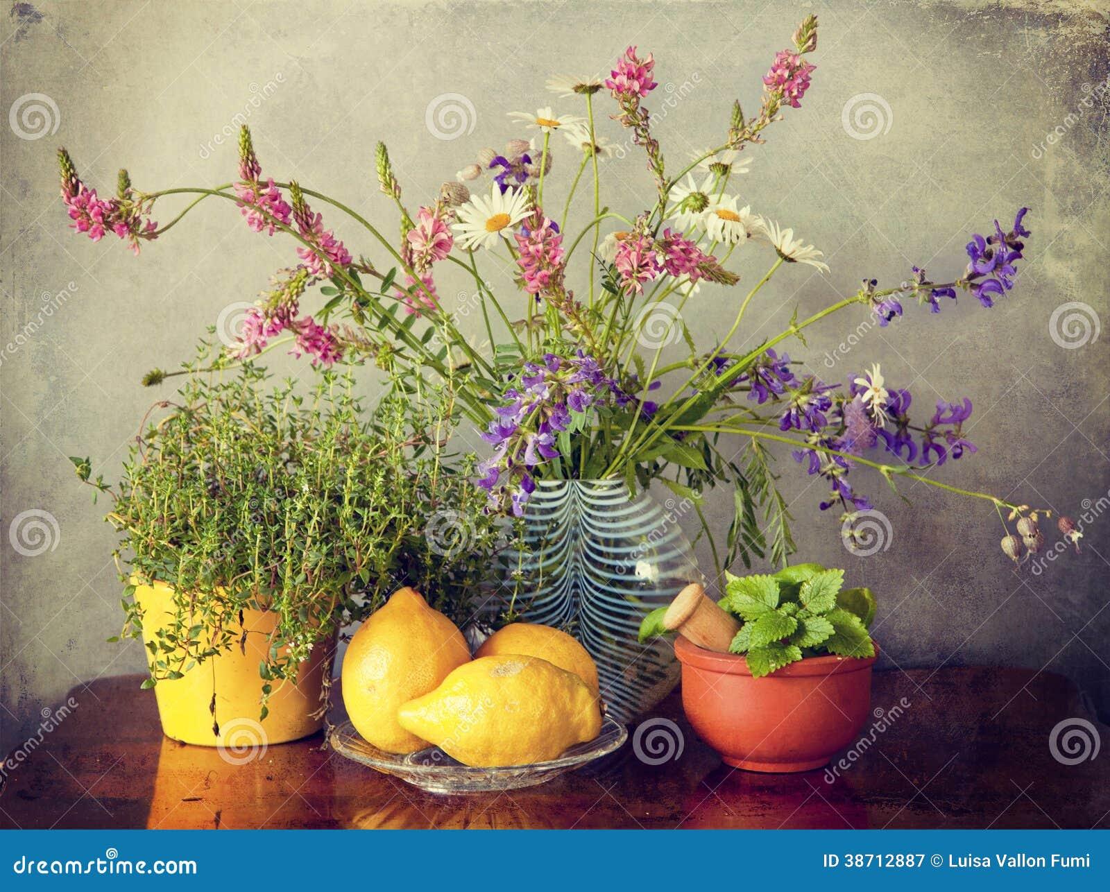 Wild Flowers In Vase, Herbs And Lemon Fruits Royalty Free