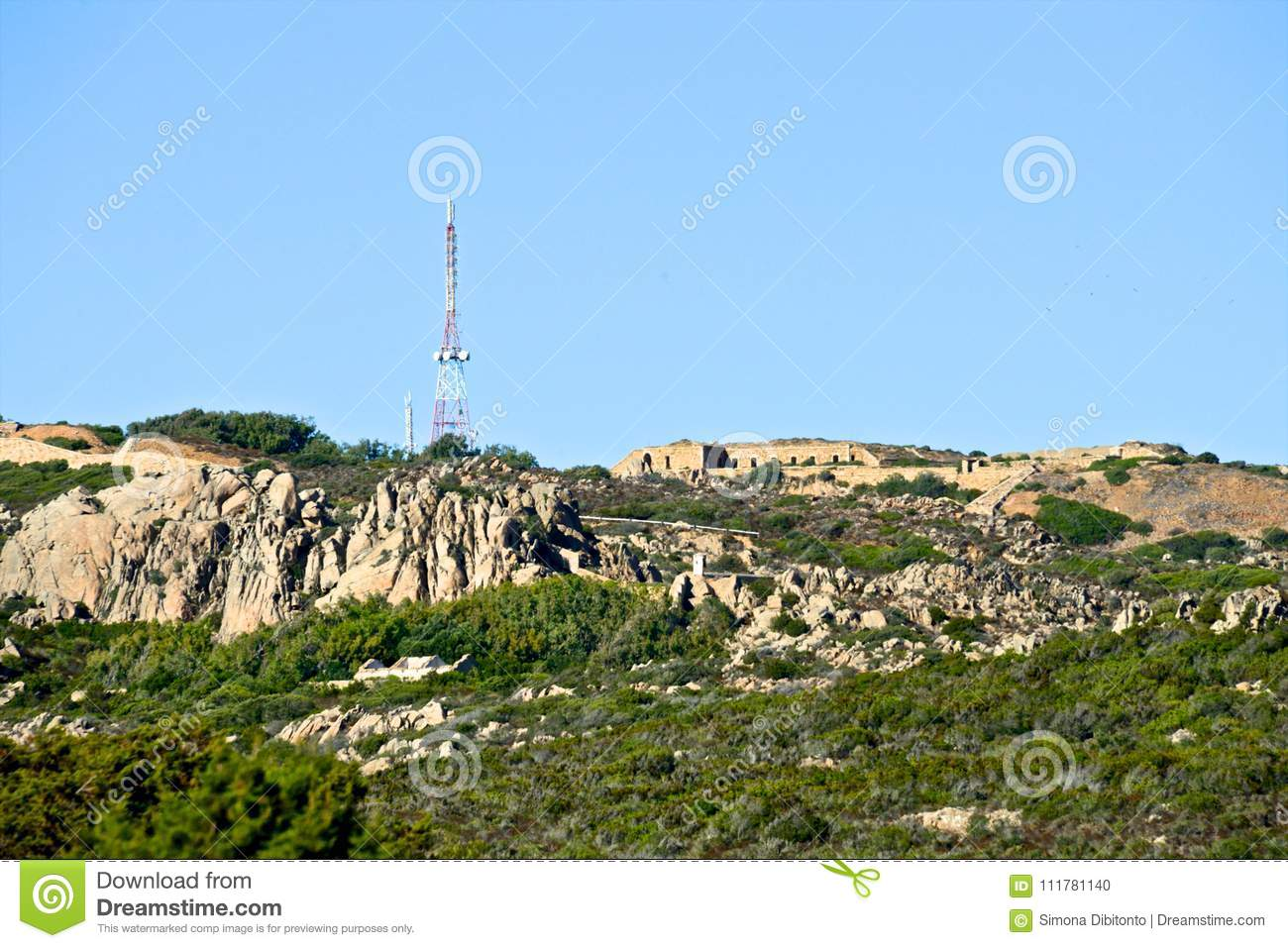 Wild nature landscape of mountain with abandoned building and big radio antenna