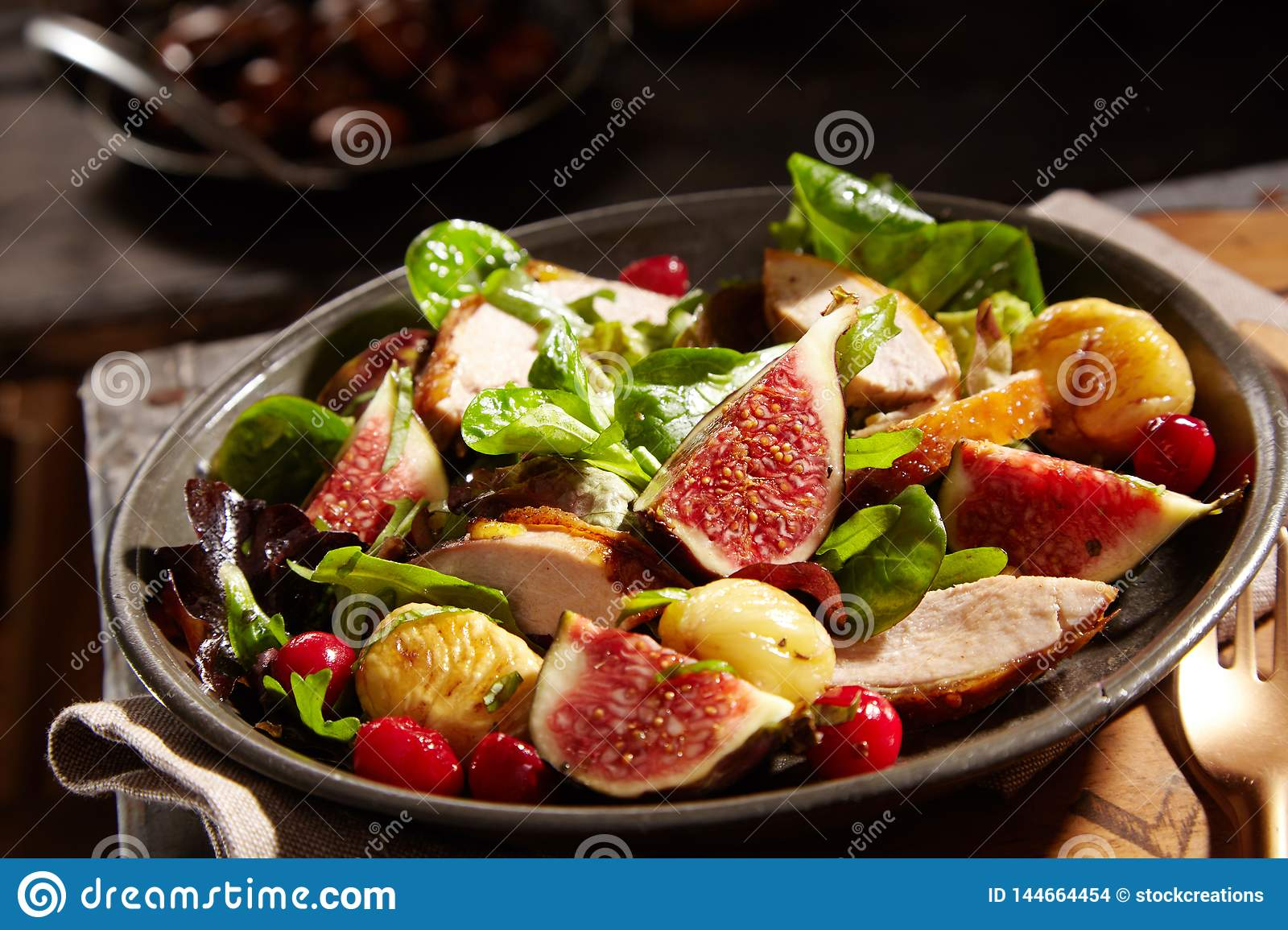 Wild salad with chestnuts, pheasant and figs