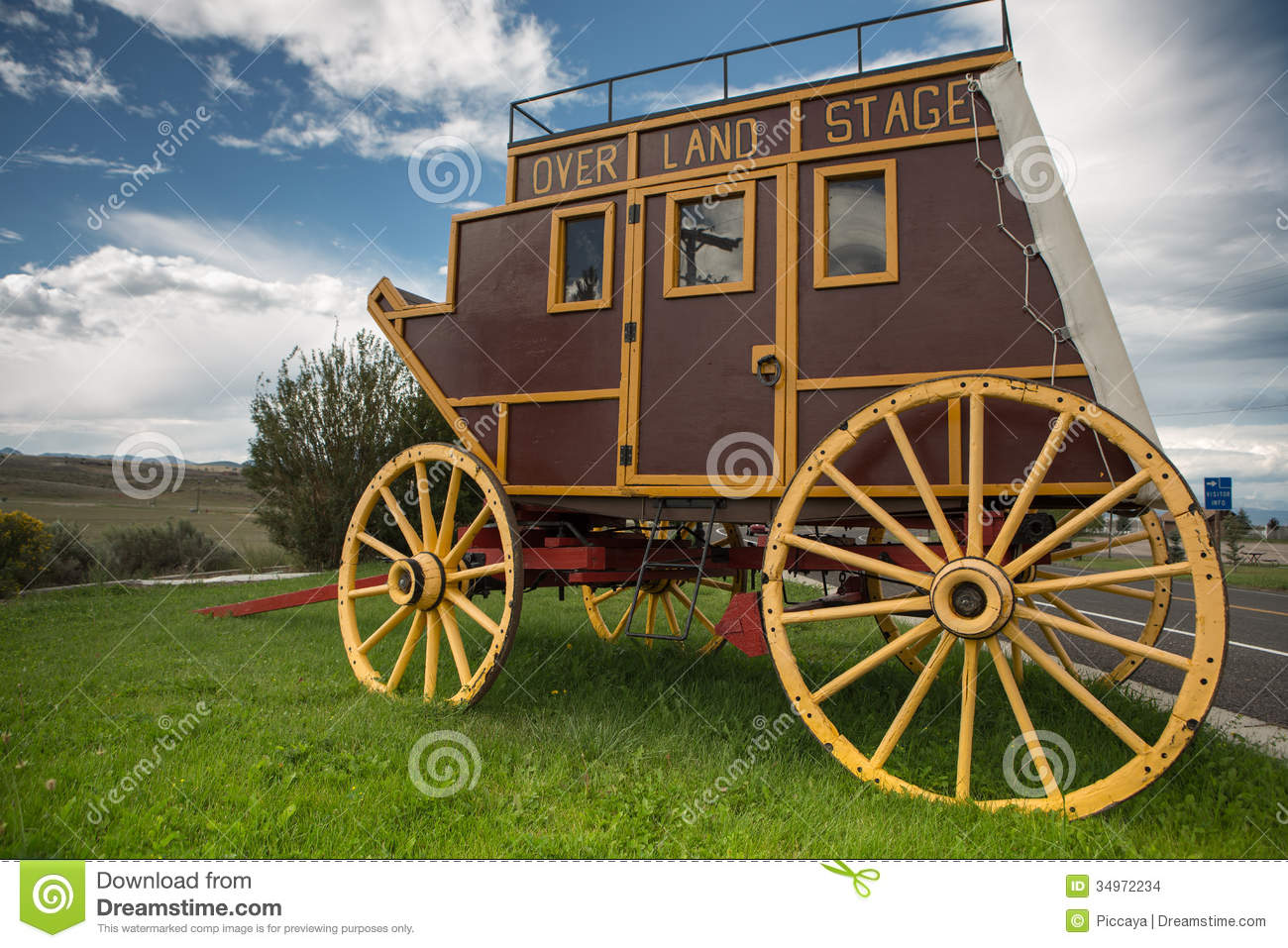Wild West covered wagon in prairie along the road in Utah.