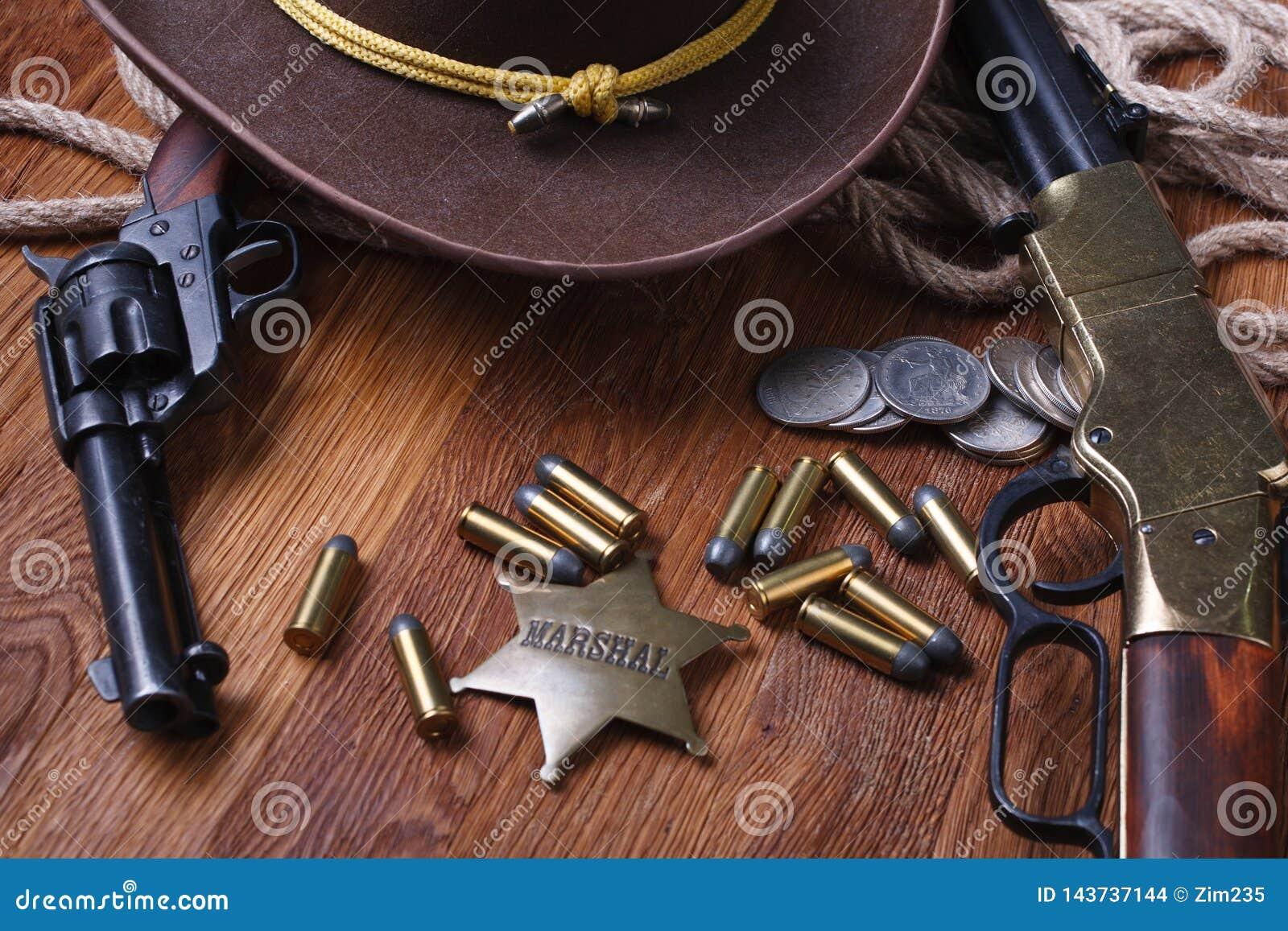 Wild west gun, ammunition and U.S. Marshal Badge