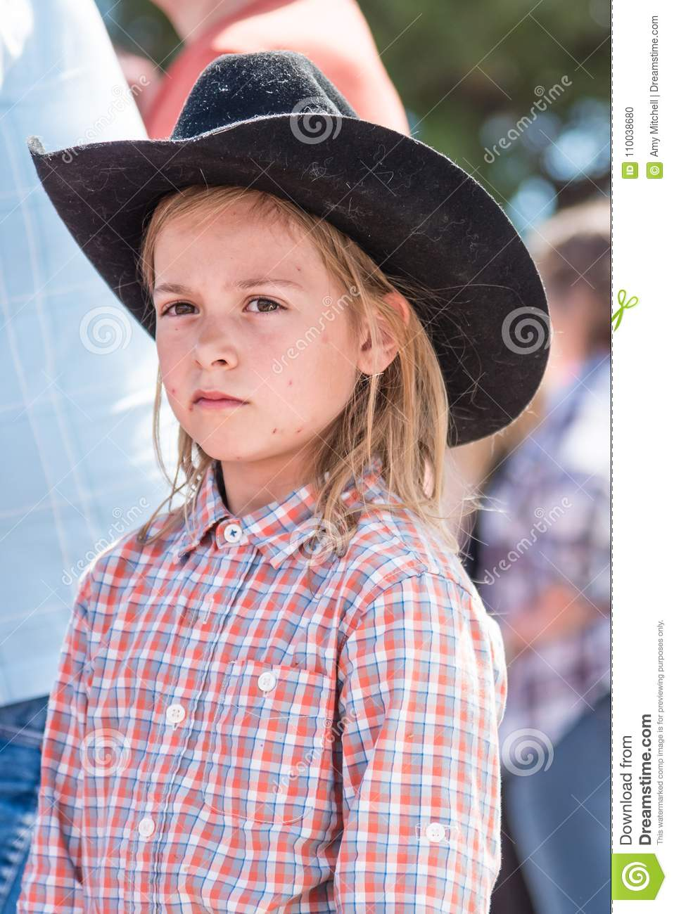 Young Girl Wearing Cowboy Hat Watches The Williams Lake