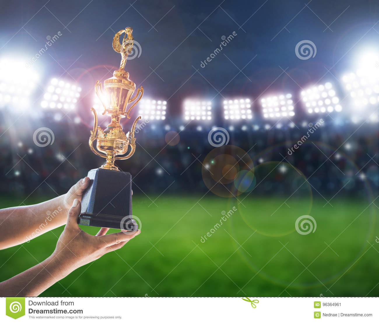 Man holding up a a gold trophy cup,win concept.
