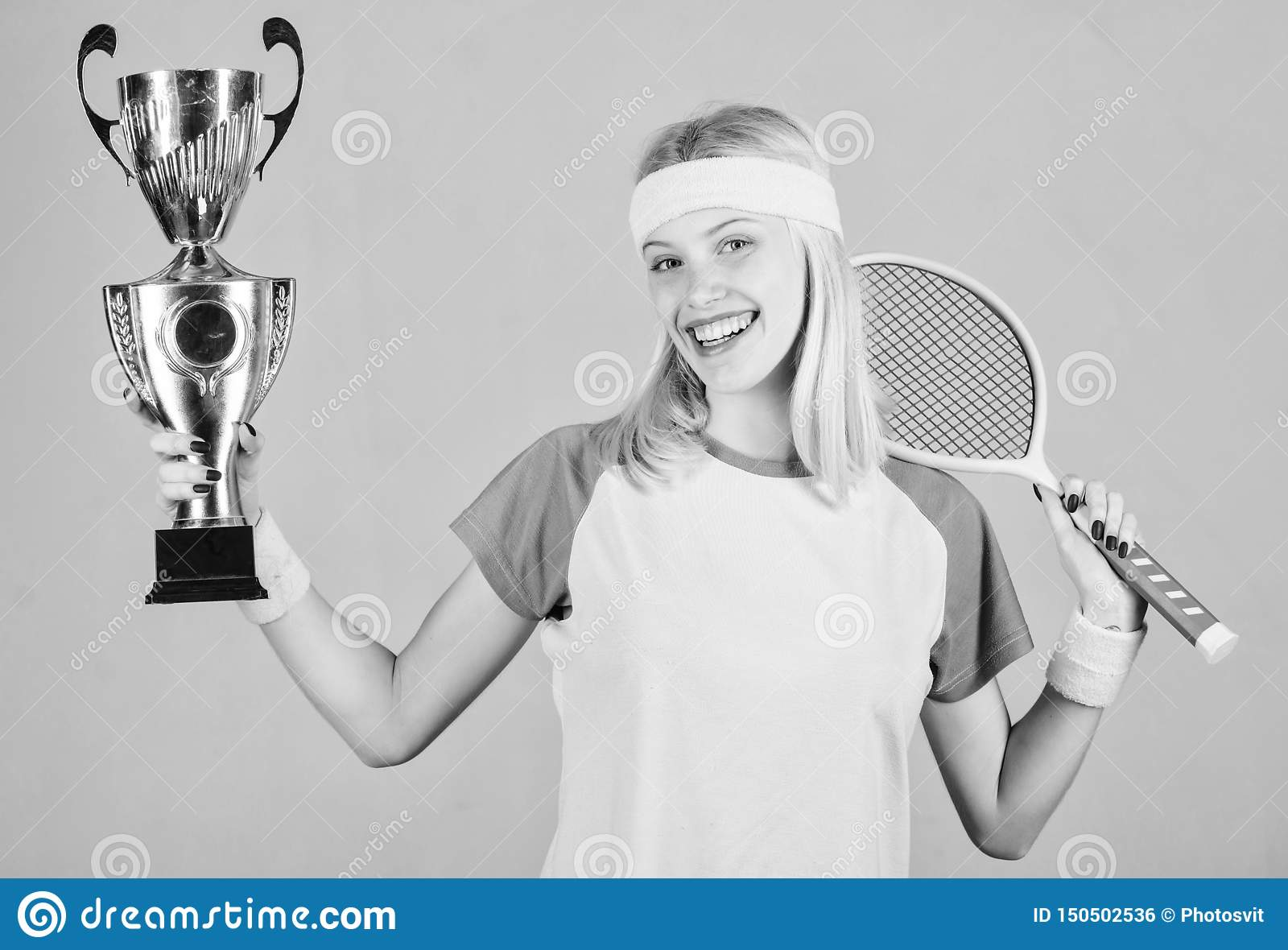 Win tennis game. Woman wear sport outfit. Tennis player win championship. First place. Sport achievement. Celebrate
