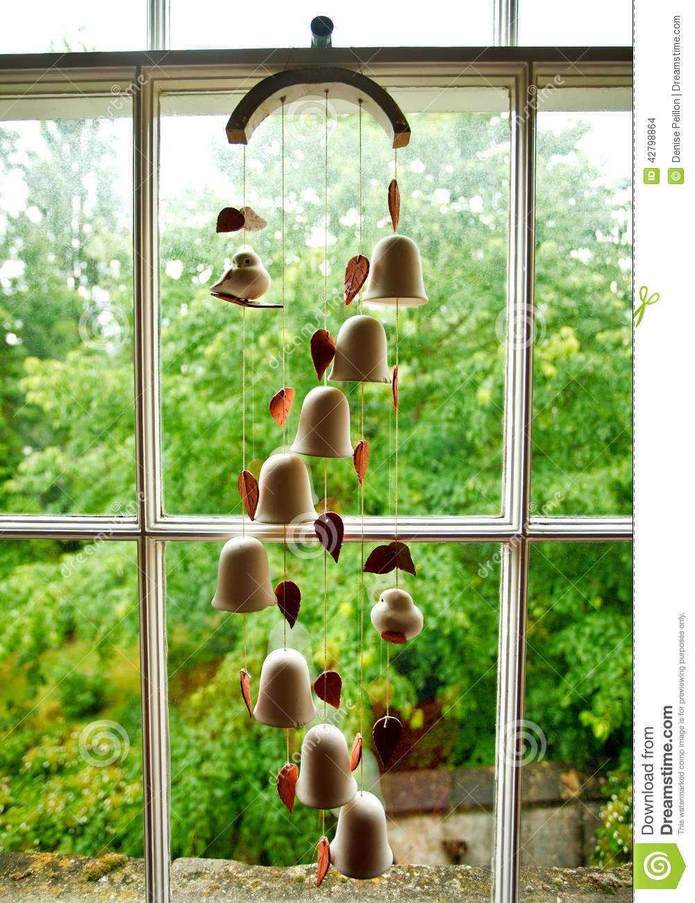 Wind Chime Of Ceramic Bells Stock Photo - Image of bells, inside