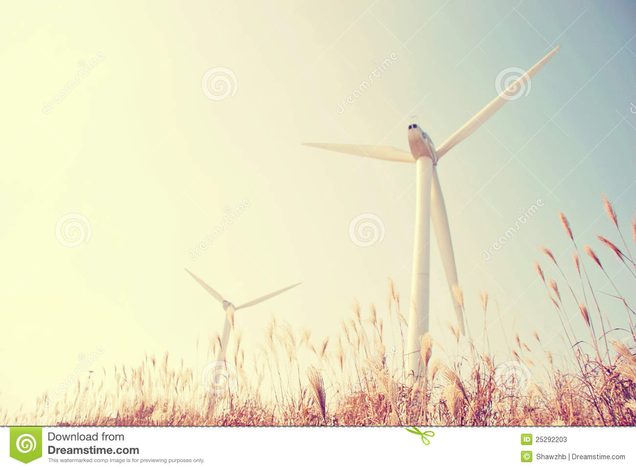 Wind energy source windmill blue sky.