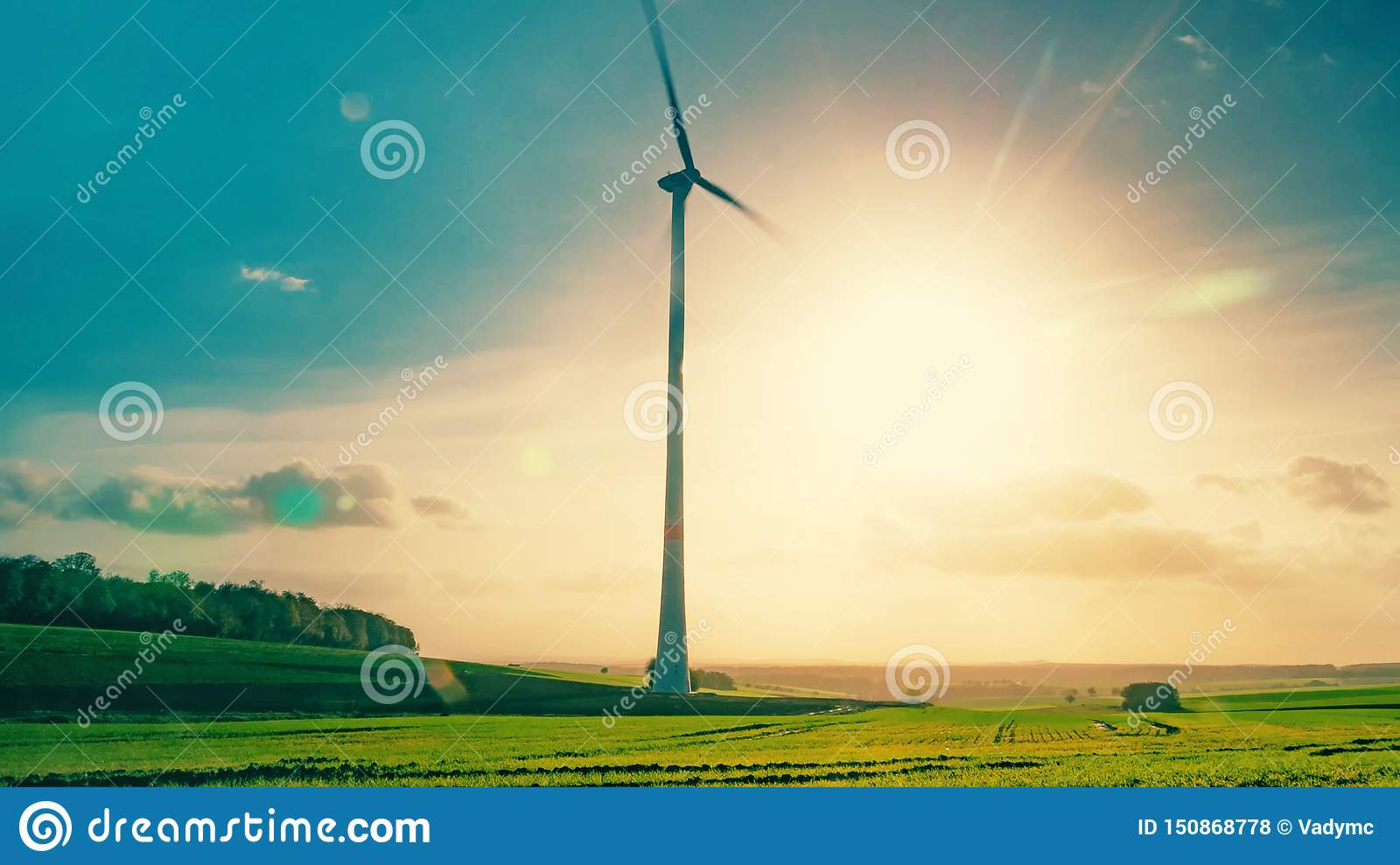 Wind Generator In Motion On The Background Of The Summer Sun