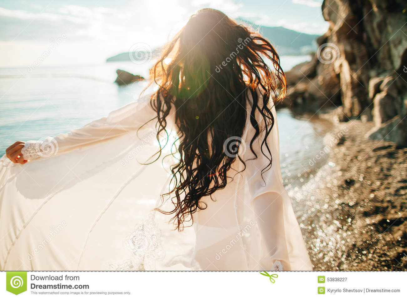 wind in hair dreamy girl with sunflare on beach stock image - image