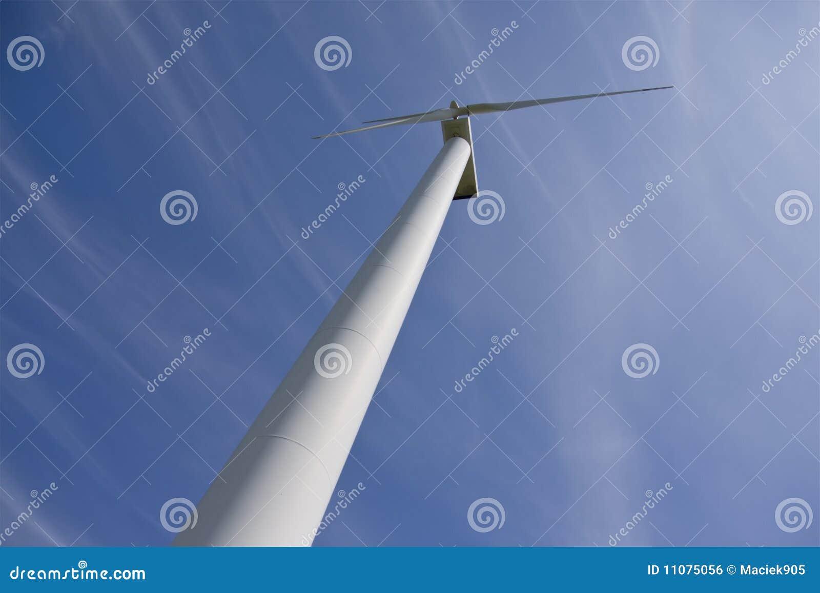 Wind power station against blue sky