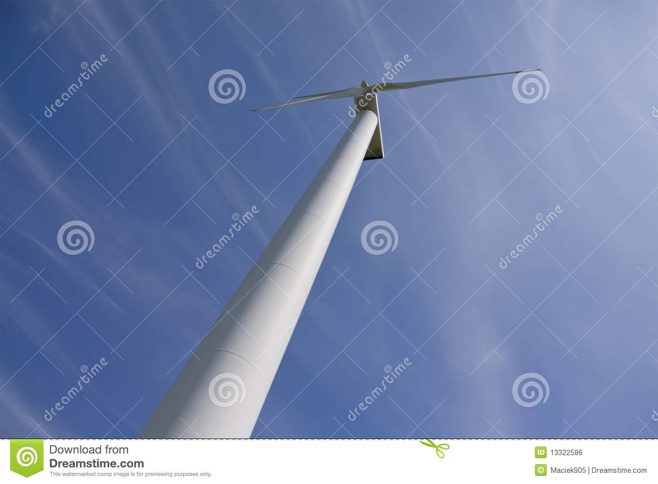 Wind power station against the blue sky