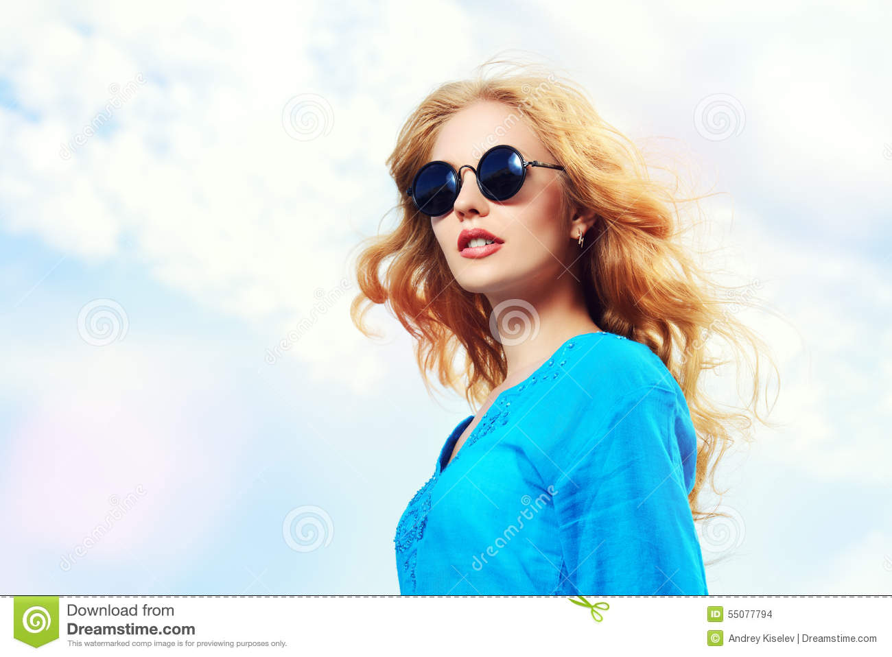 b035066a90 Gorgeous young woman with beautiful wavy hair wearing casual blouse and sunglasses  posing outdoor. Fashion shot.