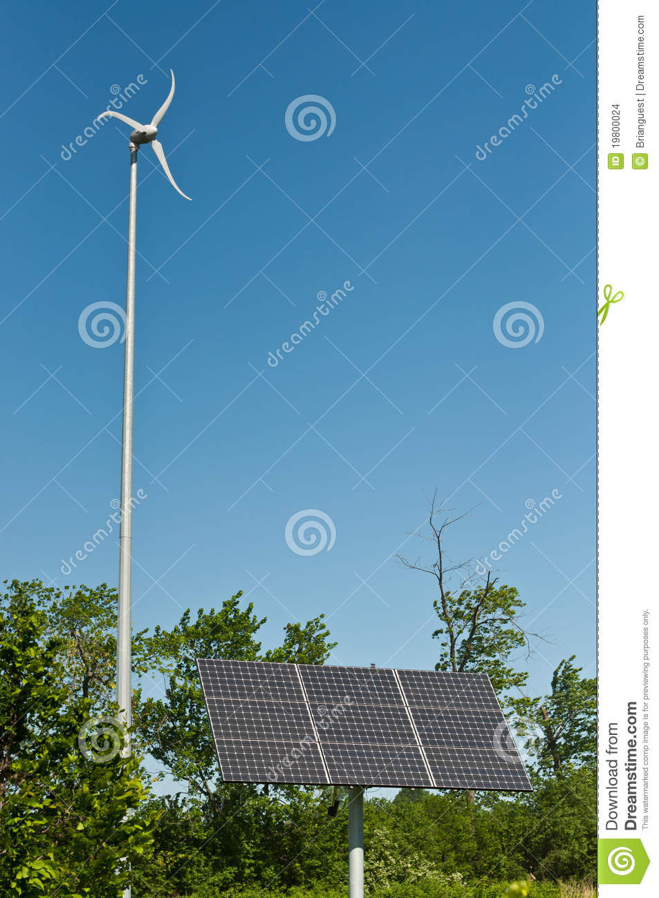 wind turbine and a photovoltaic solar panel stand next to each other ...