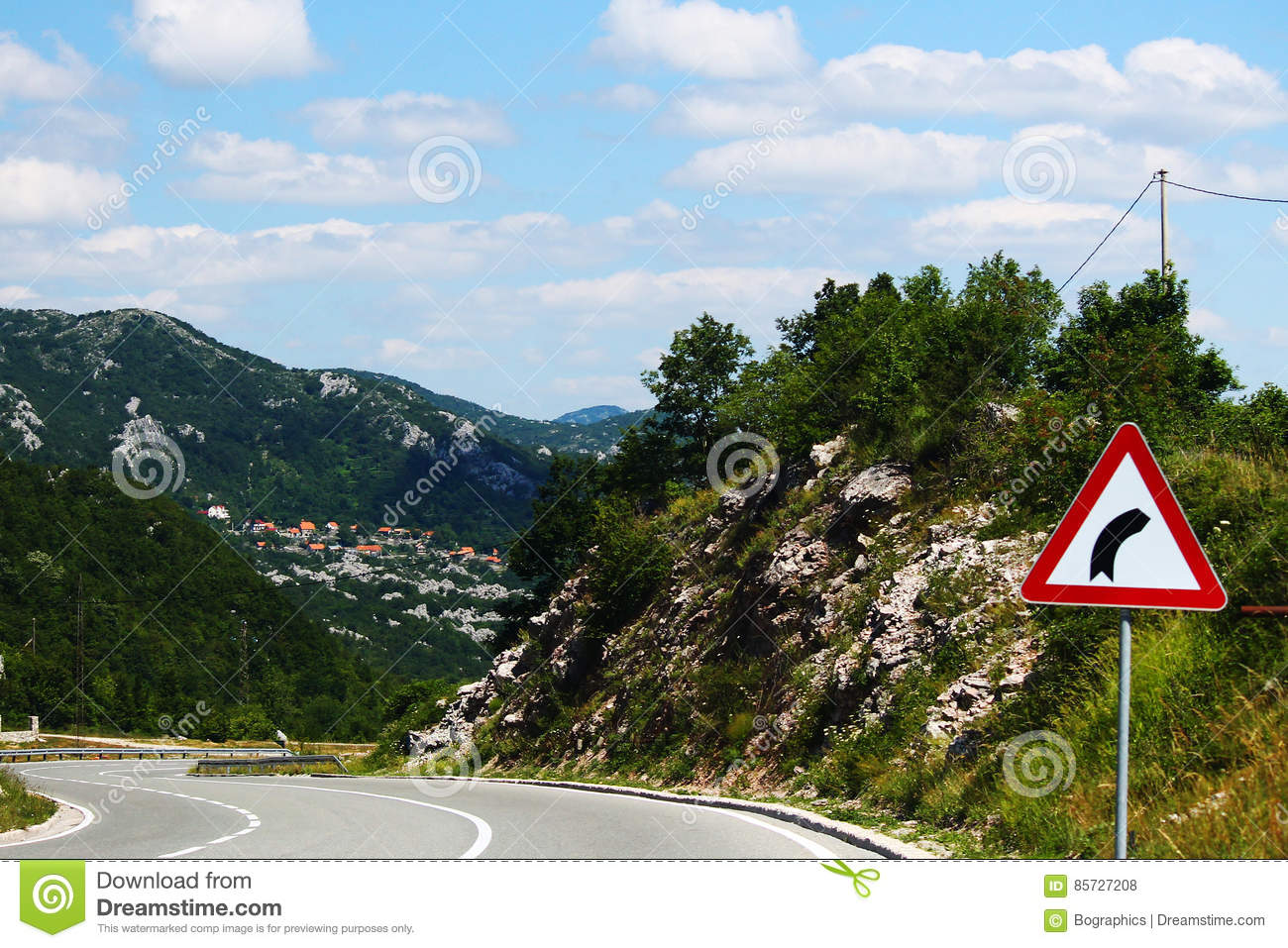 Winding road with curve sign in Montenegro