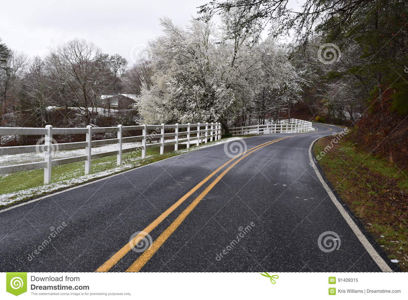Winding road with a dusting of snow
