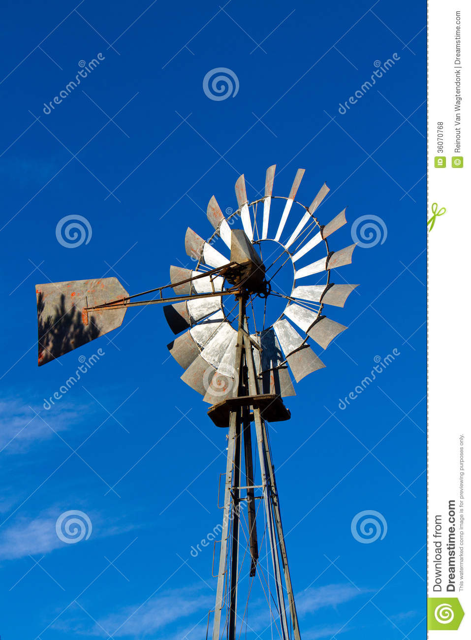 Old fashioned windmill to provide water to homestead in rural, western ...