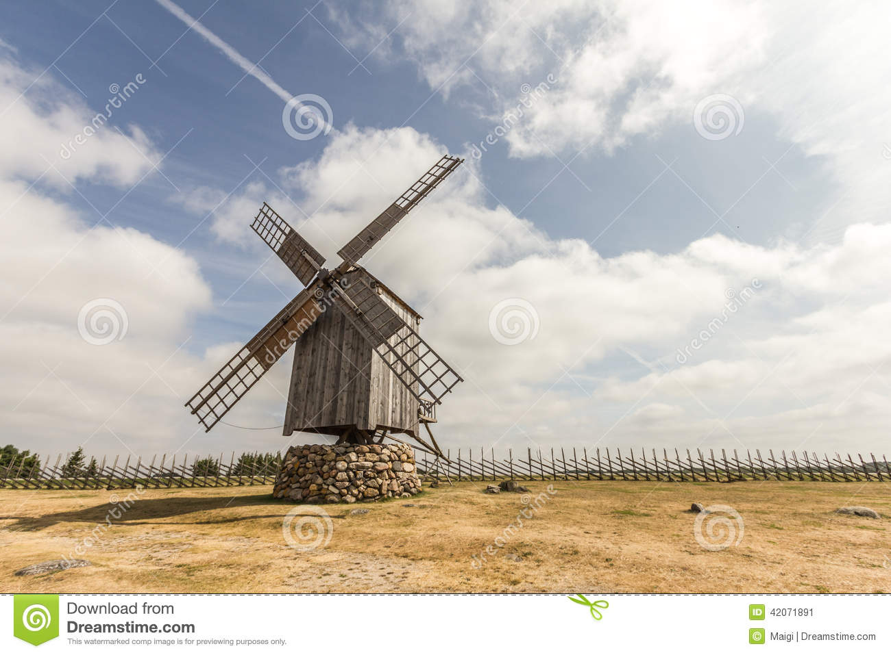Download Windmill By The Fence stock image. Image of mills, environment - 42071891
