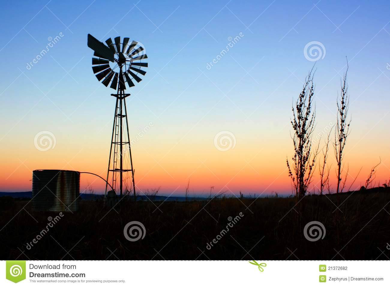 Windmill Silhouette At Sunrise. Stock Photography - Image: 21372682