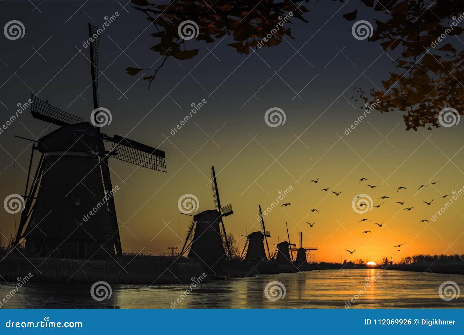 Windmill sunrise silhouette