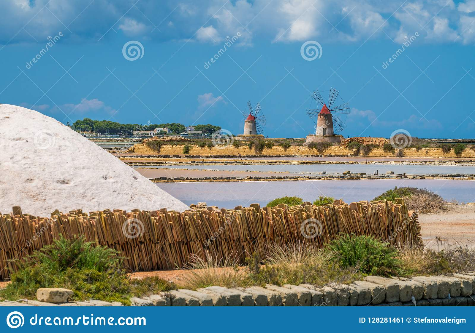 Windmills at the natural reserve of the `Saline dello Stagnone` near Marsala and Trapani, Sicily.
