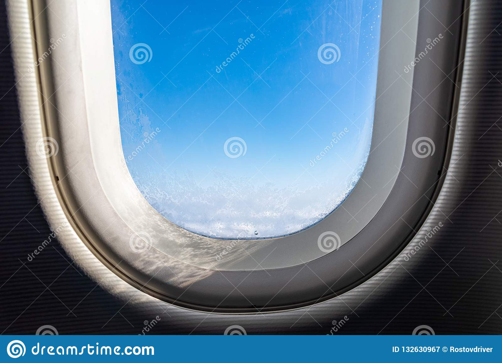 The window of the airplane. A view of porthole window on board an airbus for your travel concept or passenger air transportation