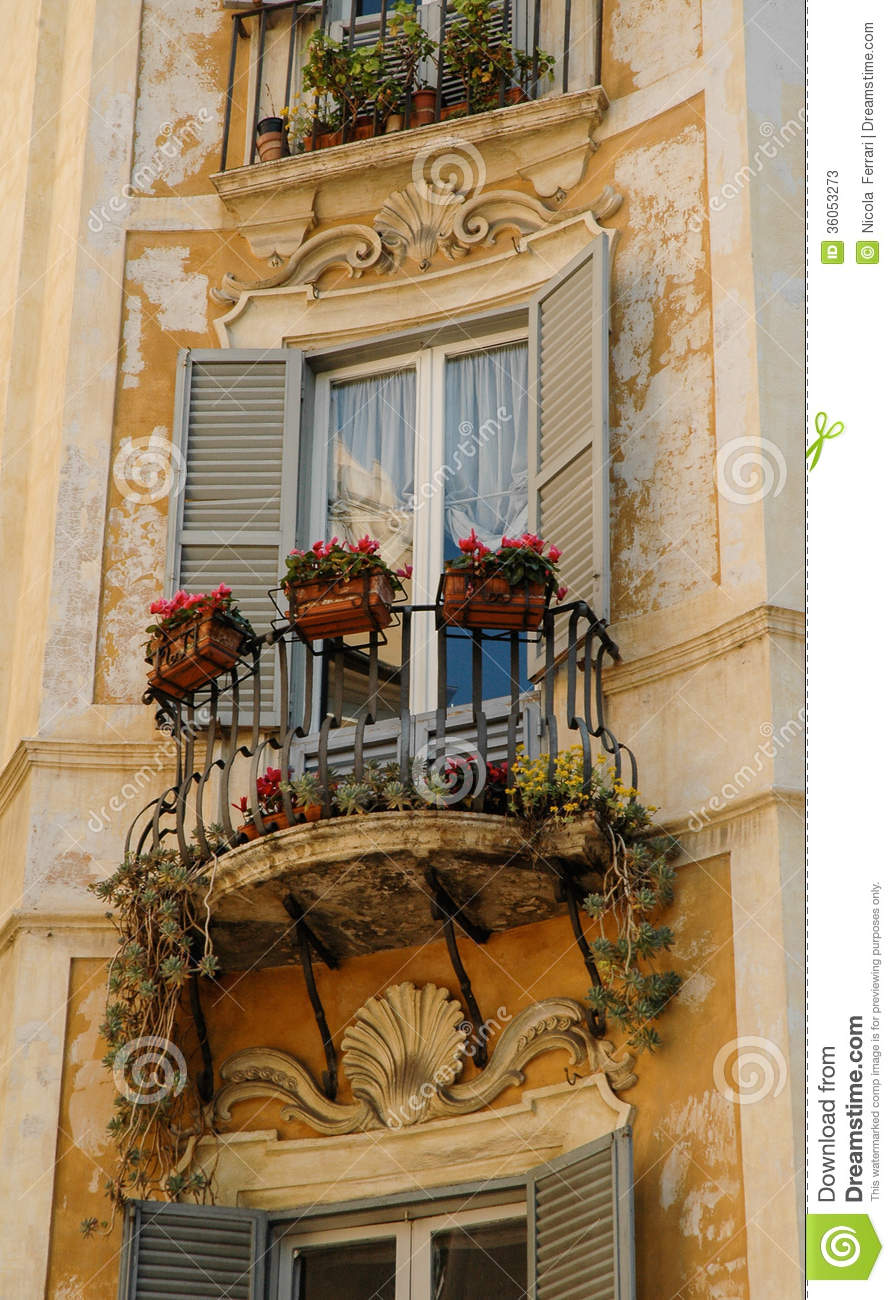 Window and balcony of a medieval italian palace stock for Balcony window