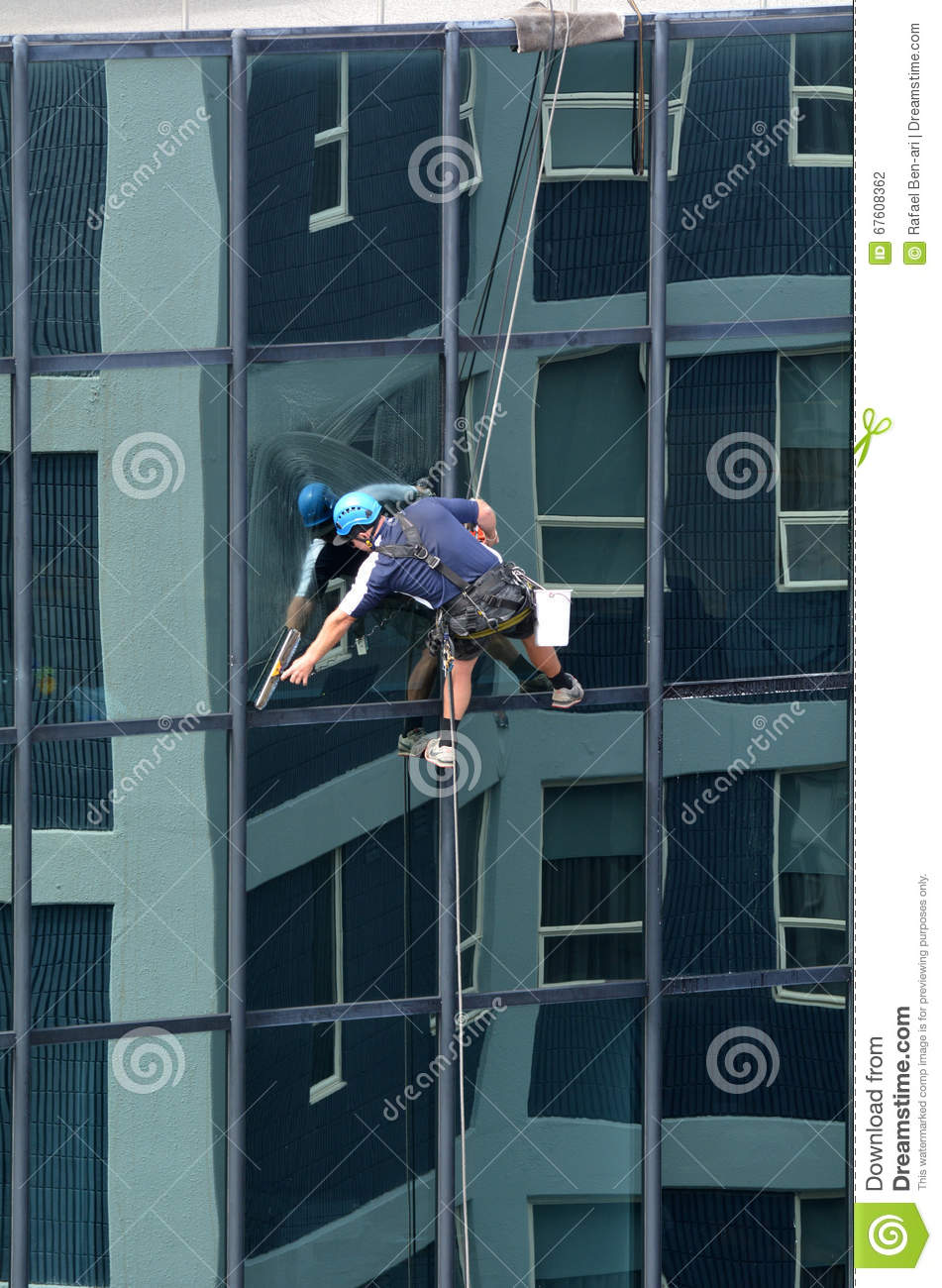 window cleaner works on high rise building