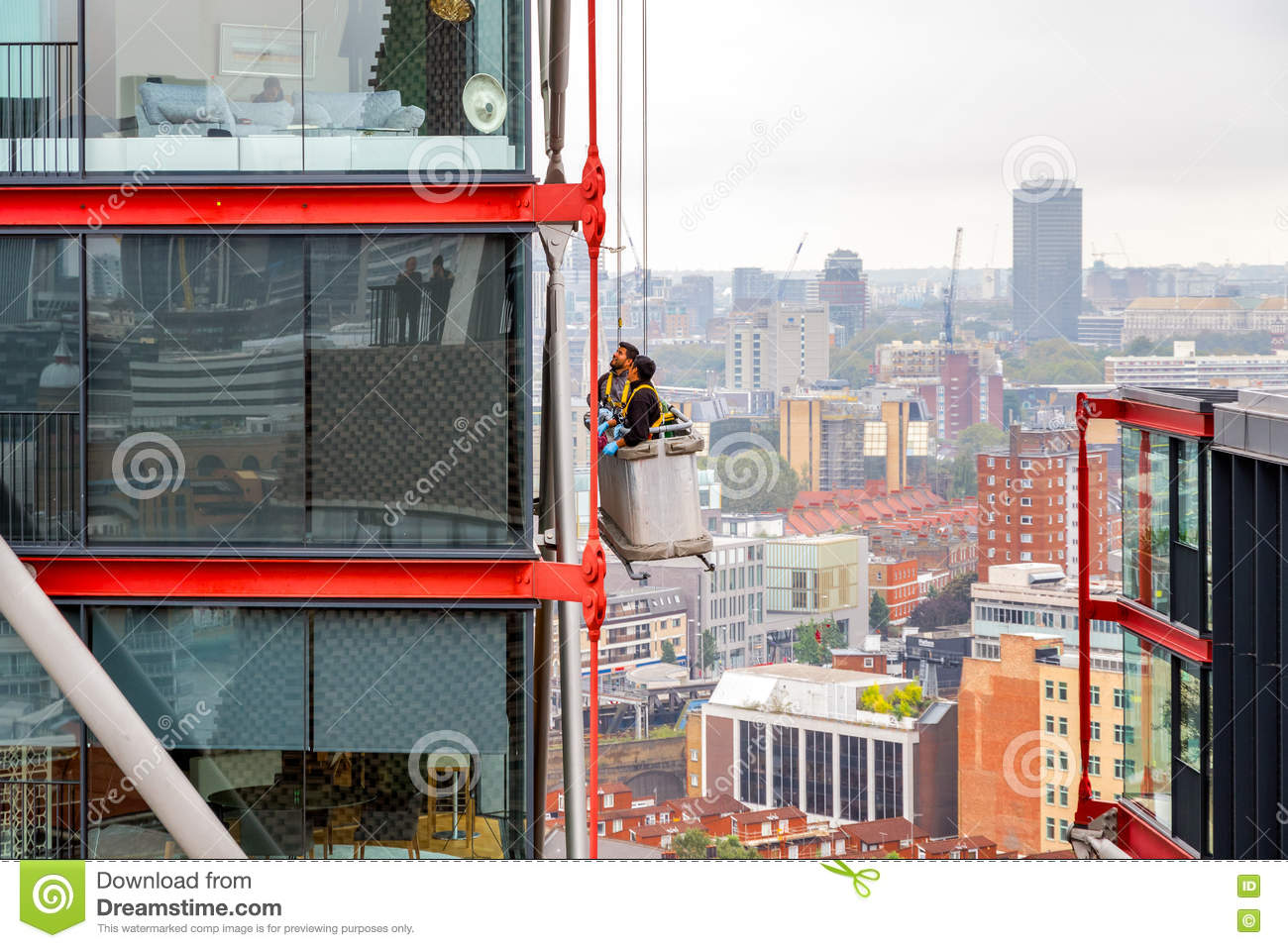 Window Cleaners Working on A High Rise Building