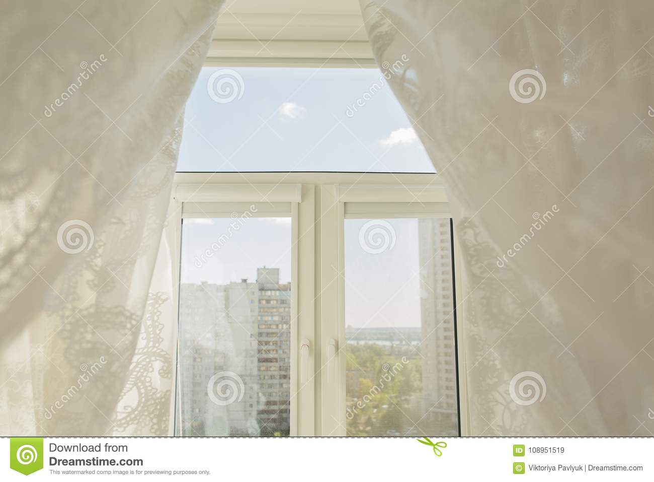 Window In A Living Room Through The Transparent Tulle Curtains
