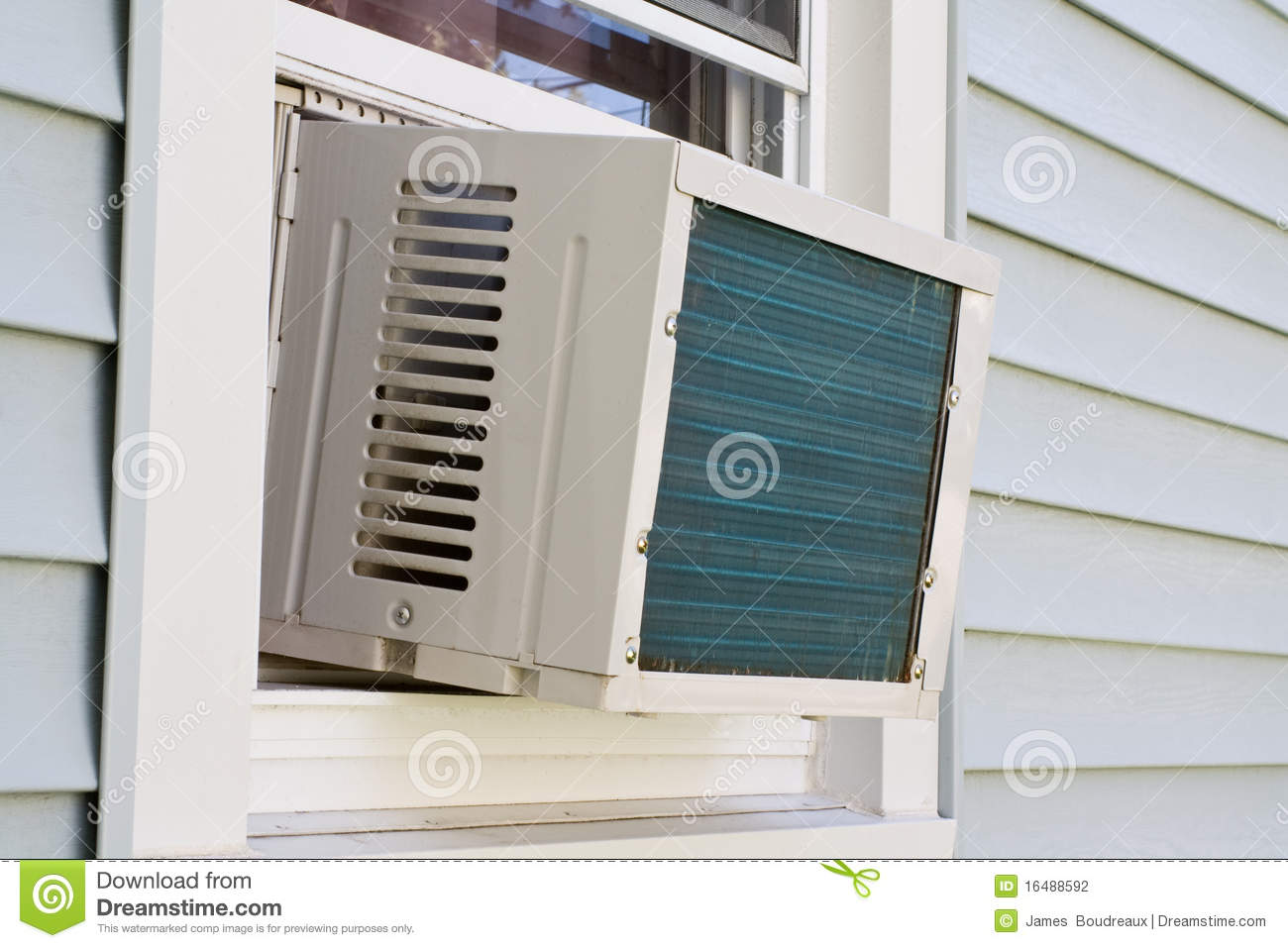 window mounted air conditioner unit sits in a residential window. #82A229
