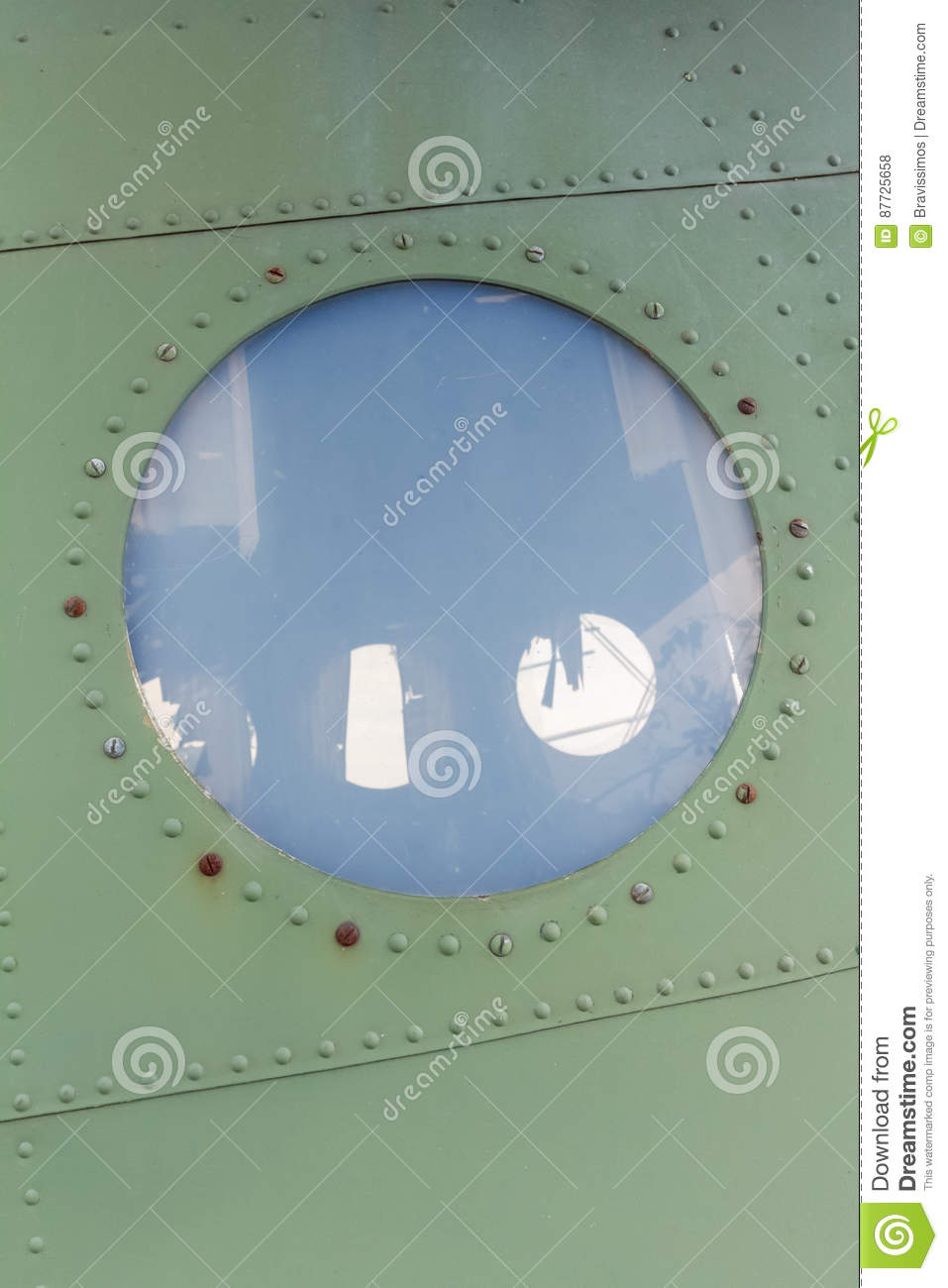 Window in old airplane, aluminum background detail of a military aircraft
