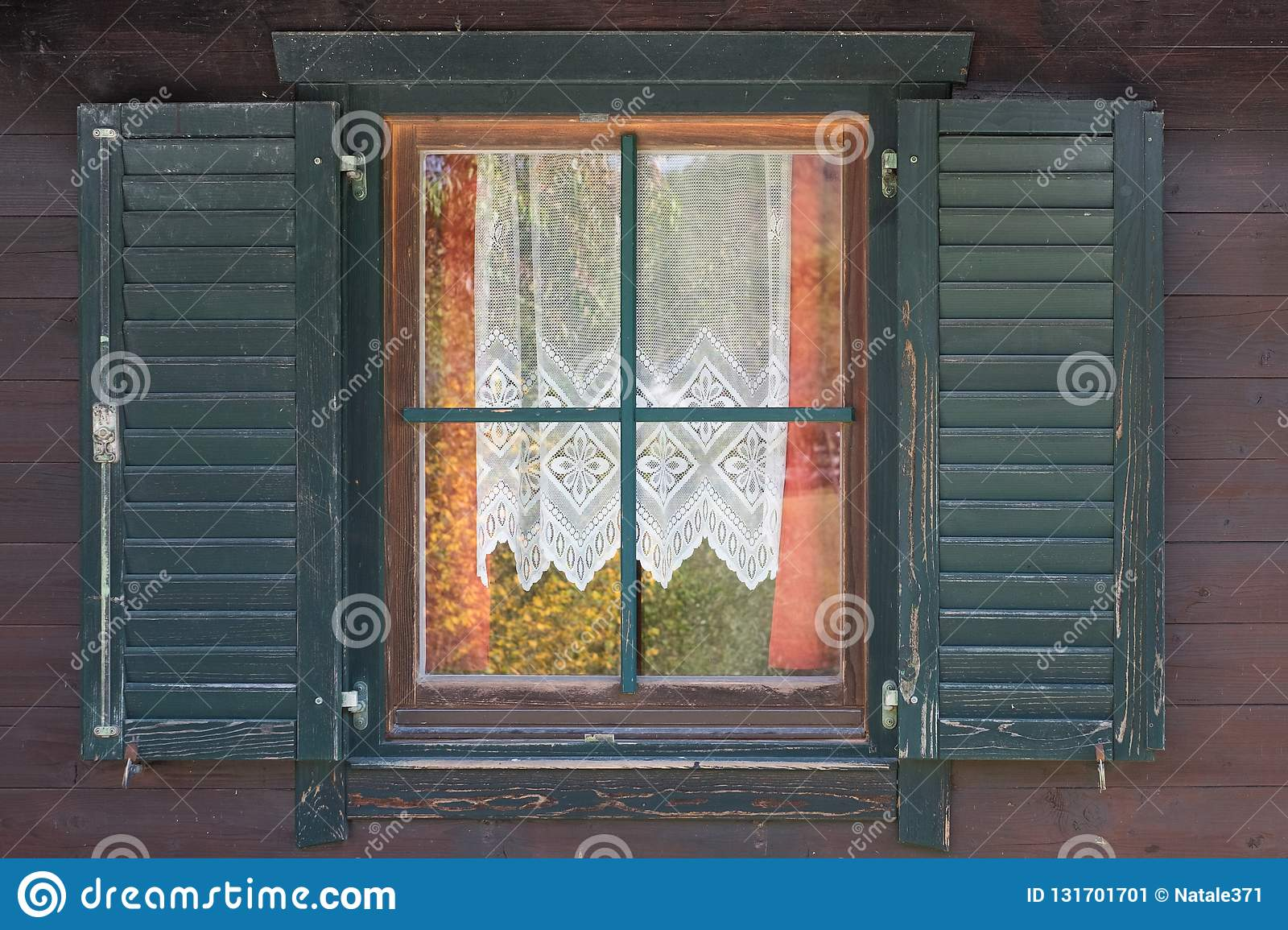 Window In The Old Style With Open Shutters And Openwork