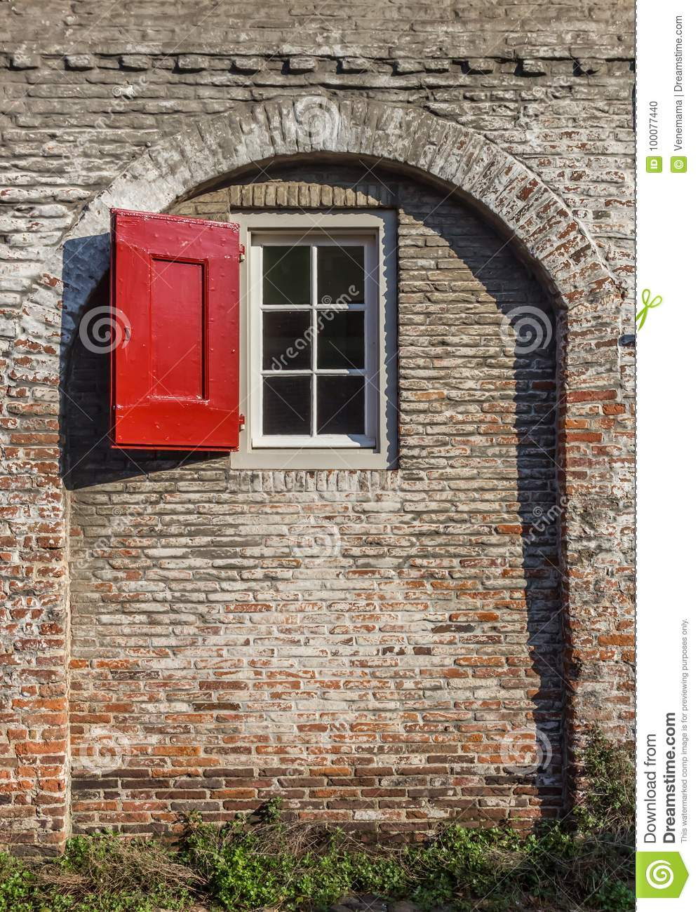 Window with red shutter in the medieval city wall of Amersfoort