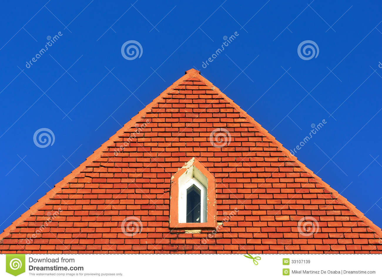 Window In A Roof Attic With Bricks Royalty Free Stock