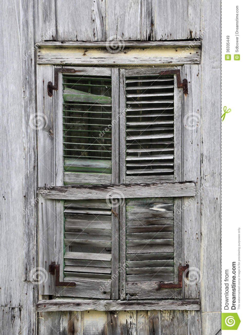 Window Shutters On Old Weathered Wooden House Stock Image