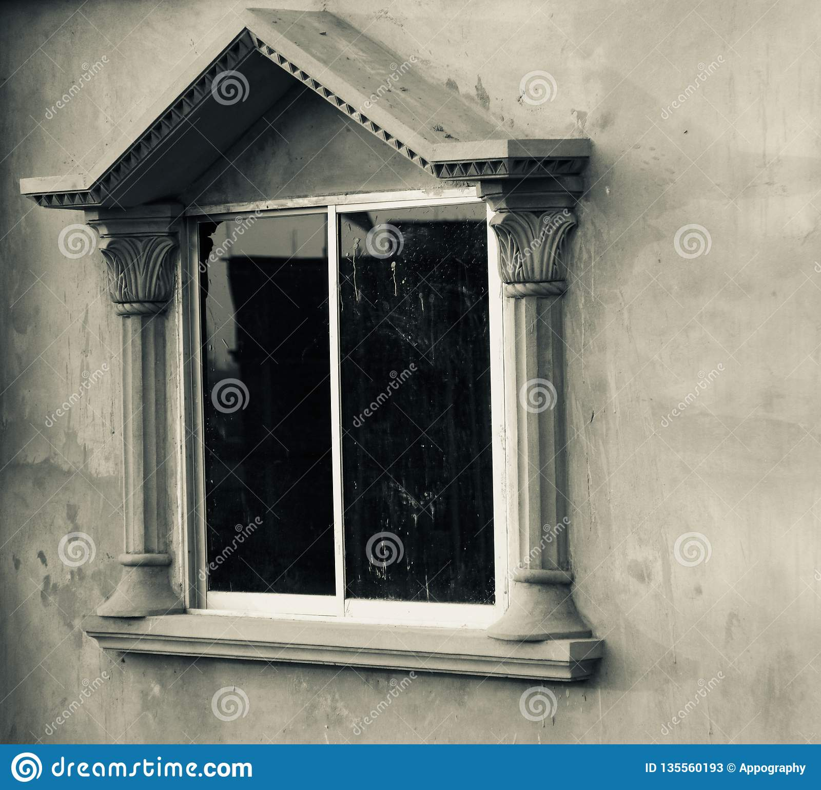 A window of a traditional concrete building