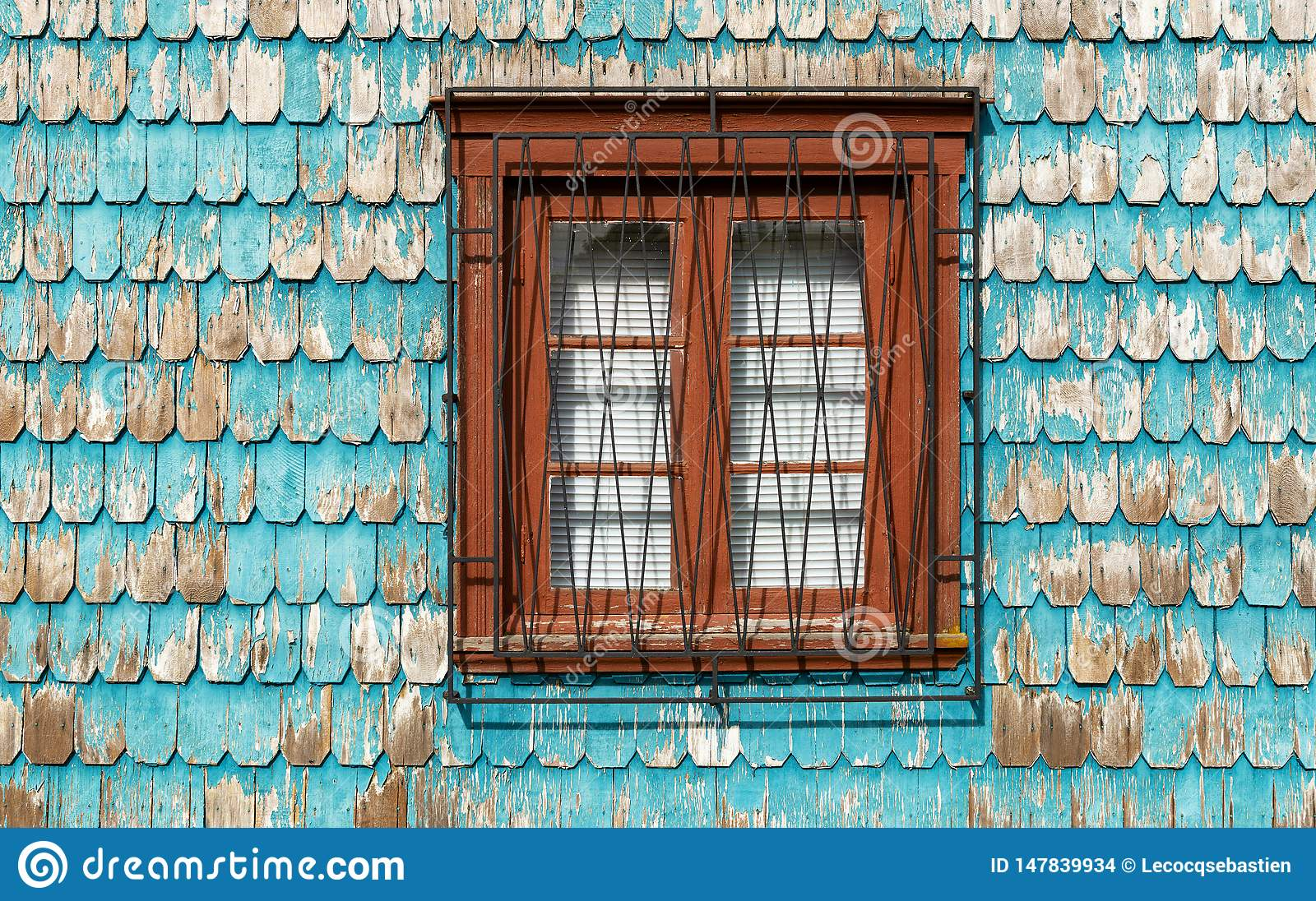 Window with turquoise wood paneling facade, Chile