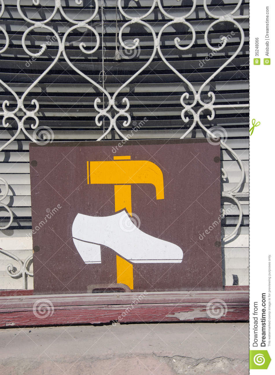 Window With Vintage Shoe Repair Shop Sign Stock Photo