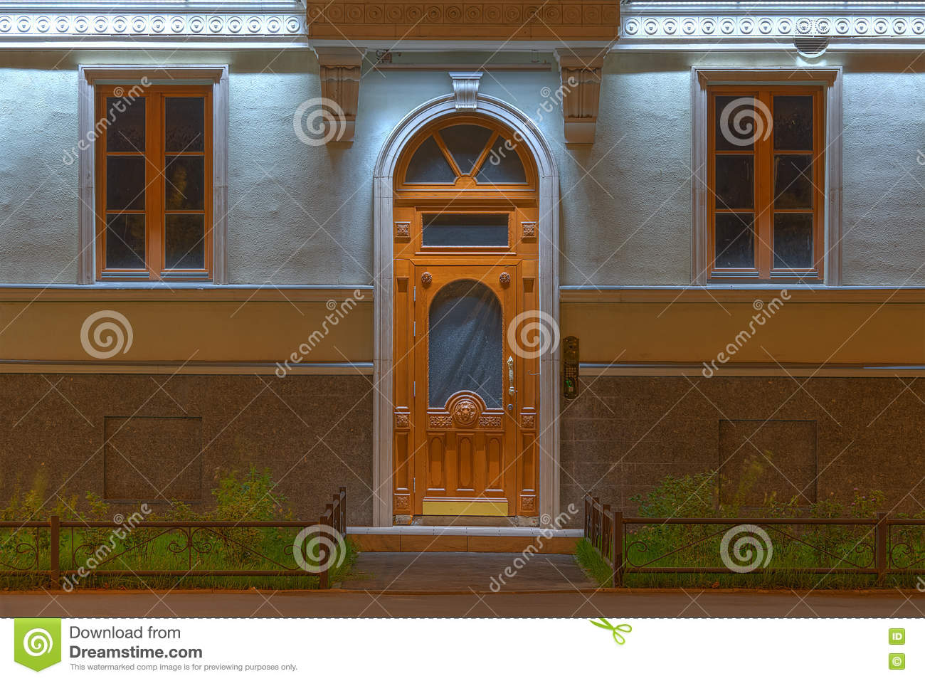 Windows And Door On Night Facade Of Apartment Building Stock Photo