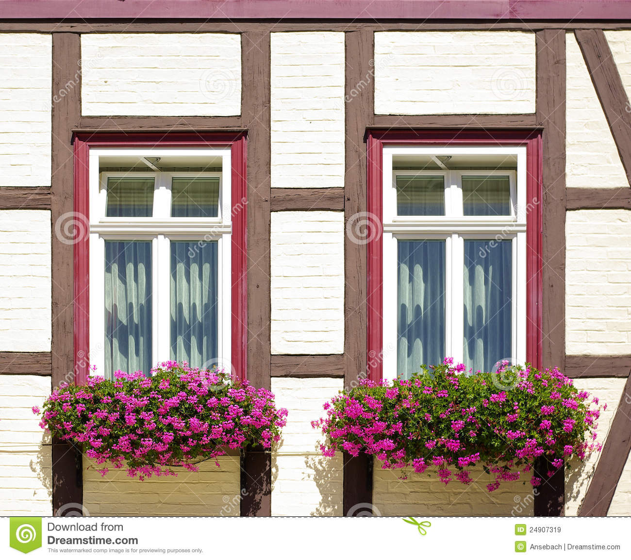 Windows With Flower Boxes At Frame Work House Stock Image