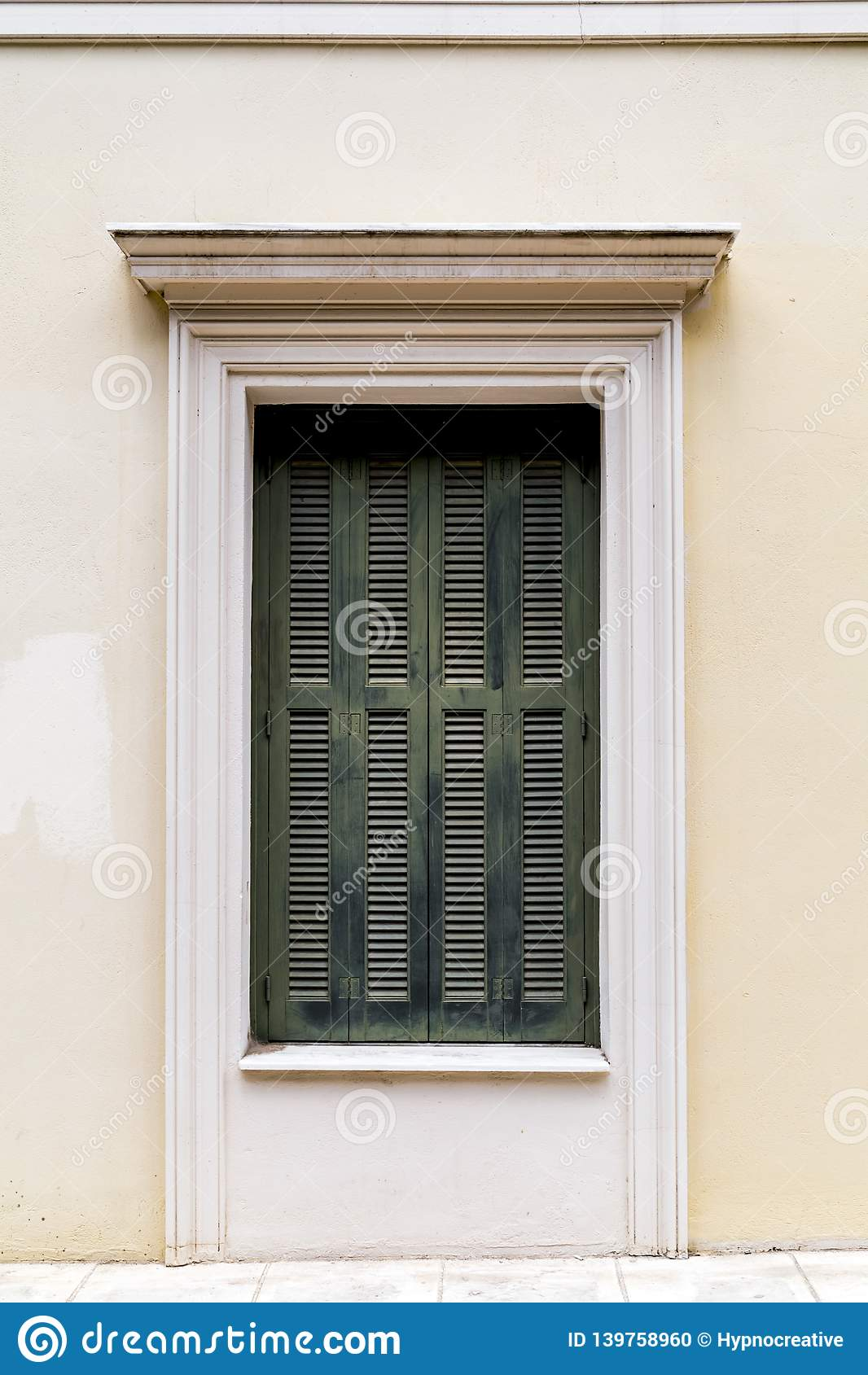 Windows with green wooden shutters stock photo