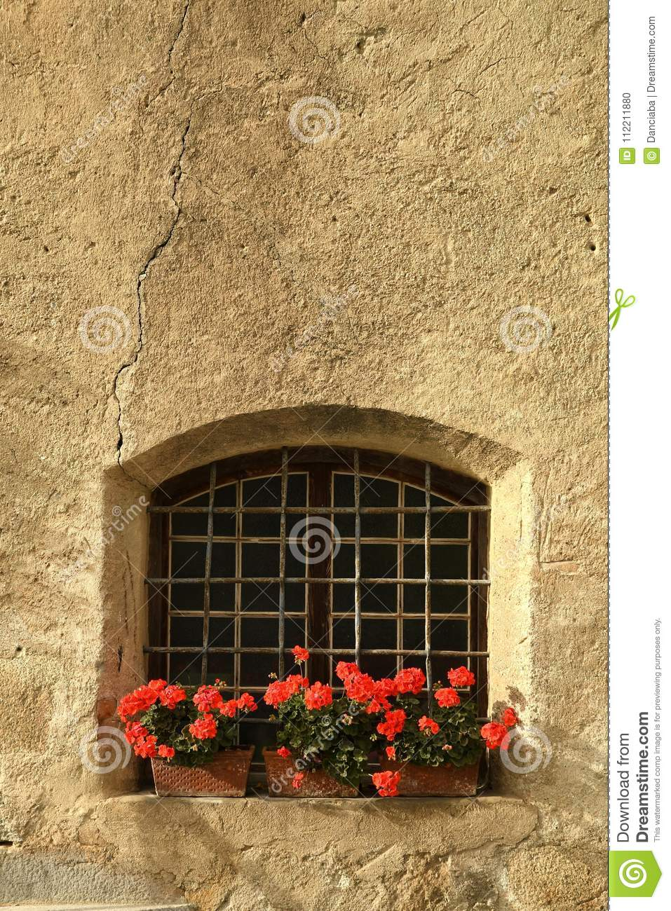 Windows With Red Flowers In The Centre Of Brixen/Bressanone  Bolzano