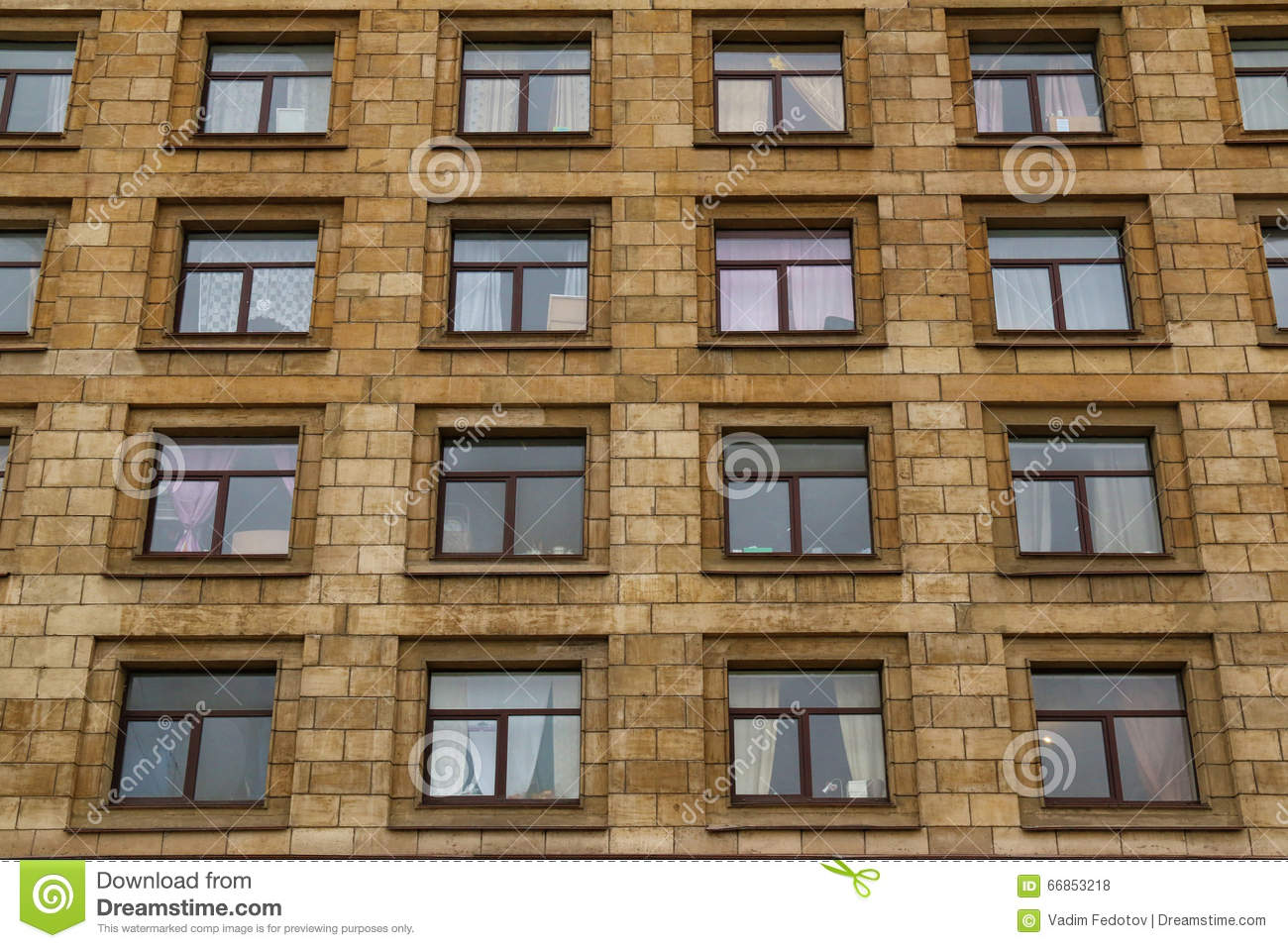 Apartment Building Front windows in a row on facade of apartment building stock photo