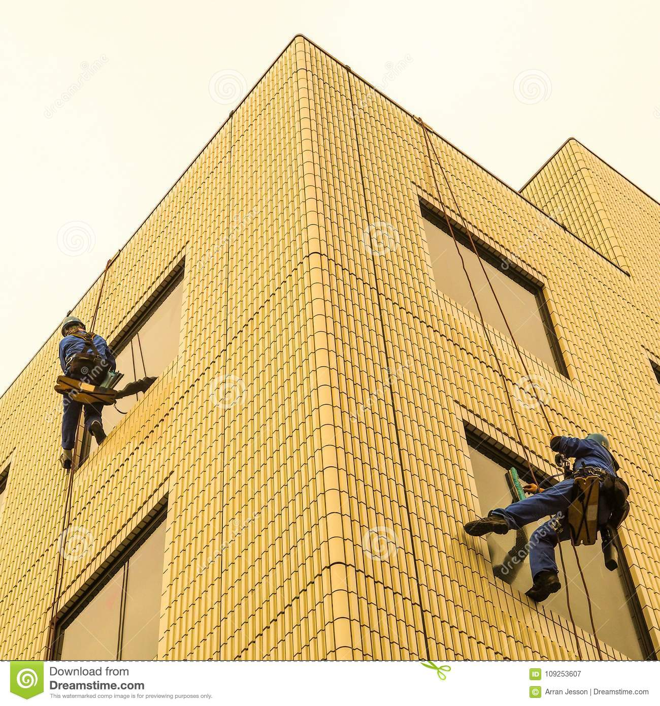Two window washers at work.