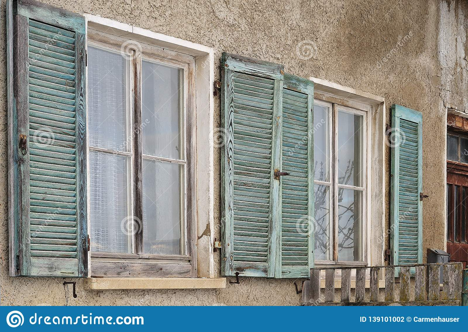 Windows With Wooden Shutters At Abandoned House Stock Photo