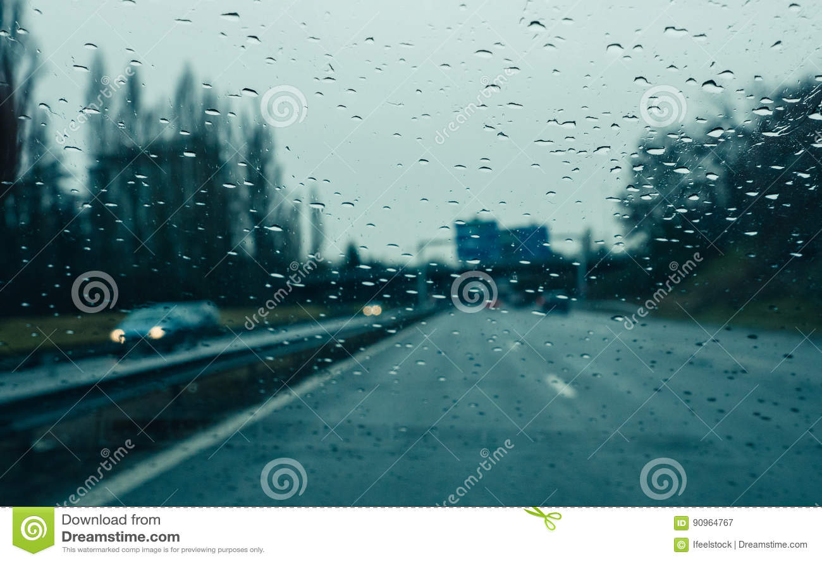 Windshield full with water drops on a heavy rain on highawy