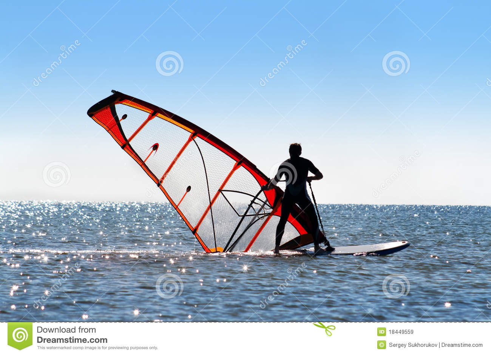 Windsurfer picks up the sail