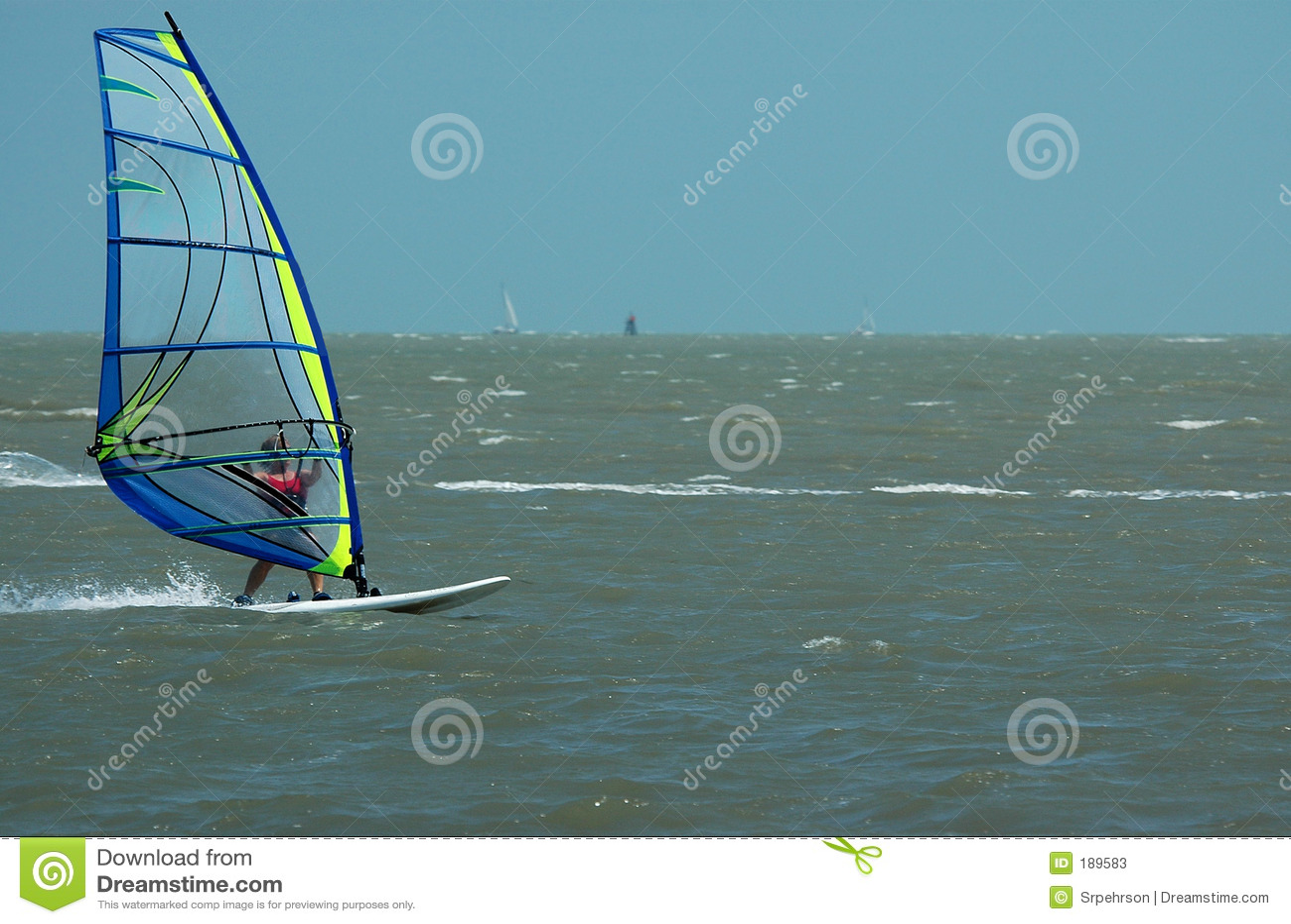 Windsurfer y barco de vela II